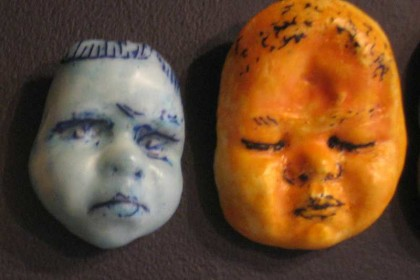 Plaster, watercolor, encaustic wax. Largest heads 6 x 5 x1 ½ ""